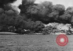Image of Clouds of smoke from burning US warships Pearl Harbor Hawaii USA, 1942, second 8 stock footage video 65675046117