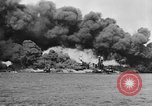 Image of Clouds of smoke from burning US warships Pearl Harbor Hawaii USA, 1942, second 10 stock footage video 65675046117