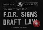 Image of President Franklin Roosevelt signs draft bill Washington DC USA, 1940, second 2 stock footage video 65675046158