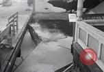 Image of waves damage waterfront property Redondo Beach California USA, 1940, second 6 stock footage video 65675046230