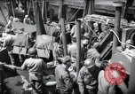Image of US 1st Infantry troops aboard ships docked in England before D-Day Weymouth England, 1944, second 9 stock footage video 65675046308