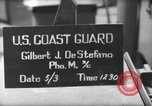 Image of U.S. Coast Guardsmen display fancy haircuts prior to D-Day Weymouth England, 1944, second 1 stock footage video 65675046309