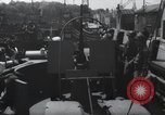 Image of U.S. Coast Guardsmen explain operation of 20mm antiaircraft gun, befor Weymouth England, 1944, second 1 stock footage video 65675046310