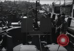 Image of U.S. Coast Guardsmen explain operation of 20mm antiaircraft gun, befor Weymouth England, 1944, second 2 stock footage video 65675046310
