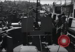 Image of U.S. Coast Guardsmen explain operation of 20mm antiaircraft gun, befor Weymouth England, 1944, second 3 stock footage video 65675046310