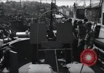 Image of U.S. Coast Guardsmen explain operation of 20mm antiaircraft gun, befor Weymouth England, 1944, second 4 stock footage video 65675046310