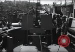 Image of U.S. Coast Guardsmen explain operation of 20mm antiaircraft gun, befor Weymouth England, 1944, second 5 stock footage video 65675046310