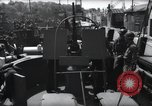 Image of U.S. Coast Guardsmen explain operation of 20mm antiaircraft gun, befor Weymouth England, 1944, second 6 stock footage video 65675046310