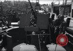 Image of U.S. Coast Guardsmen explain operation of 20mm antiaircraft gun, befor Weymouth England, 1944, second 7 stock footage video 65675046310