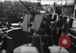 Image of U.S. Coast Guardsmen explain operation of 20mm antiaircraft gun, befor Weymouth England, 1944, second 8 stock footage video 65675046310
