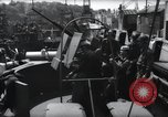 Image of U.S. Coast Guardsmen explain operation of 20mm antiaircraft gun, befor Weymouth England, 1944, second 9 stock footage video 65675046310