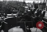Image of U.S. Coast Guardsmen explain operation of 20mm antiaircraft gun, befor Weymouth England, 1944, second 10 stock footage video 65675046310