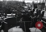 Image of U.S. Coast Guardsmen explain operation of 20mm antiaircraft gun, befor Weymouth England, 1944, second 11 stock footage video 65675046310