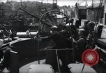 Image of U.S. Coast Guardsmen explain operation of 20mm antiaircraft gun, befor Weymouth England, 1944, second 12 stock footage video 65675046310