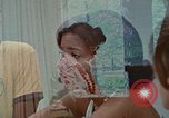 Image of female students and navy United States USA, 1975, second 1 stock footage video 65675046351