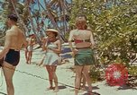Image of people at beach Pacific Theater, 1945, second 4 stock footage video 65675046444