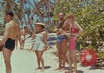 Image of people at beach Pacific Theater, 1945, second 5 stock footage video 65675046444