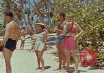 Image of people at beach Pacific Theater, 1945, second 6 stock footage video 65675046444