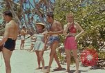 Image of people at beach Pacific Theater, 1945, second 7 stock footage video 65675046444