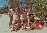 Image of people at beach Pacific Theater, 1945, second 9 stock footage video 65675046444