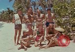 Image of people at beach Pacific Theater, 1945, second 10 stock footage video 65675046444