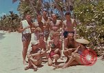 Image of people at beach Pacific Theater, 1945, second 11 stock footage video 65675046444