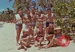 Image of people at beach Pacific Theater, 1945, second 12 stock footage video 65675046444