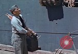 Image of Coast Guard Chief Petty Officer photographer Pacific Theater, 1945, second 4 stock footage video 65675046451