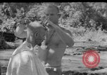 Image of haircut Bougainville Island Papua New Guinea, 1944, second 1 stock footage video 65675046501