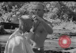 Image of haircut Bougainville Island Papua New Guinea, 1944, second 2 stock footage video 65675046501