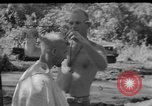 Image of haircut Bougainville Island Papua New Guinea, 1944, second 3 stock footage video 65675046501