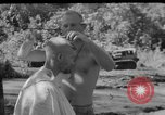 Image of haircut Bougainville Island Papua New Guinea, 1944, second 4 stock footage video 65675046501