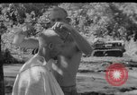 Image of haircut Bougainville Island Papua New Guinea, 1944, second 5 stock footage video 65675046501