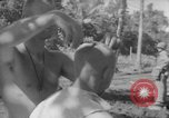 Image of haircut Bougainville Island Papua New Guinea, 1944, second 6 stock footage video 65675046501