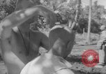 Image of haircut Bougainville Island Papua New Guinea, 1944, second 7 stock footage video 65675046501