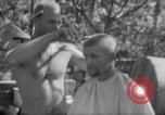 Image of haircut Bougainville Island Papua New Guinea, 1944, second 9 stock footage video 65675046501
