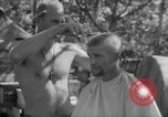 Image of haircut Bougainville Island Papua New Guinea, 1944, second 10 stock footage video 65675046501