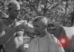 Image of haircut Bougainville Island Papua New Guinea, 1944, second 11 stock footage video 65675046501