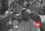 Image of haircut Bougainville Island Papua New Guinea, 1944, second 12 stock footage video 65675046501