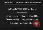 Image of aerial automobile jump Atlantic City New Jersey USA, 1930, second 4 stock footage video 65675046573