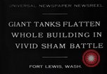 Image of tank damages old building Fort Lewis Washington USA, 1930, second 1 stock footage video 65675046578