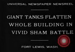 Image of tank damages old building Fort Lewis Washington USA, 1930, second 3 stock footage video 65675046578