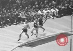 Image of indoor mile championship United States USA, 1941, second 8 stock footage video 65675046744