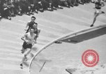 Image of indoor mile championship United States USA, 1941, second 9 stock footage video 65675046744