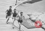 Image of indoor mile championship United States USA, 1941, second 10 stock footage video 65675046744