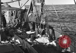 Image of fishing boat at work Atlantic Ocean Massachusetts United States USA, 1935, second 5 stock footage video 65675046885