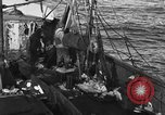 Image of fishing boat at work Atlantic Ocean Massachusetts United States USA, 1935, second 9 stock footage video 65675046885