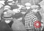 Image of sullen crowd views Canadian fishing boat Boston Massachusetts USA, 1935, second 1 stock footage video 65675046899