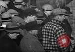 Image of sullen crowd views Canadian fishing boat Boston Massachusetts USA, 1935, second 3 stock footage video 65675046899