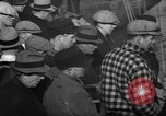 Image of sullen crowd views Canadian fishing boat Boston Massachusetts USA, 1935, second 4 stock footage video 65675046899